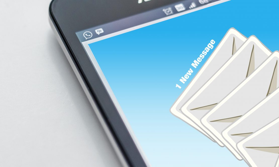 A cellphone showing an inbox with a new email