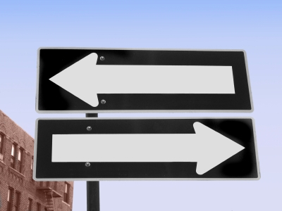 two one-way signs pointing in different directions