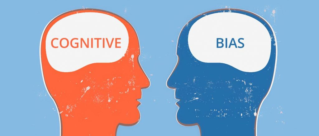 two heads with the words cognitive and bias