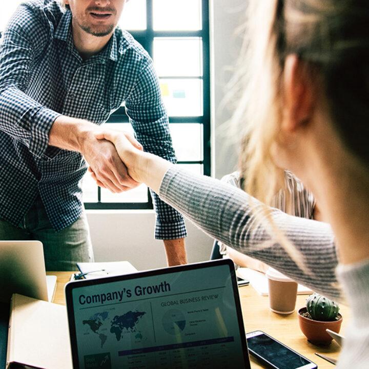 Handshake across a desk