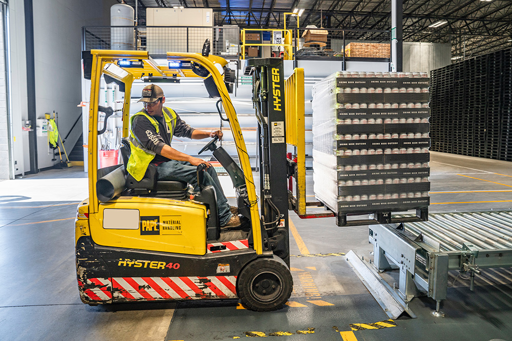 Forklift operator in a warehouse
